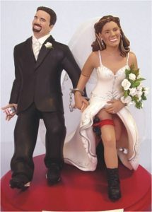 Seems to me that the bride is an undercover cop as I see with the hidden gun in the holster. And the groom is the crook. Either way, this wedding cake topper looks very sleazy to say the least.