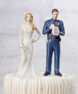 I suppose this wedding cake topper is for a cop. Still, for a second I thought he either had her pulled over or she was giving a description of her runaway groom.