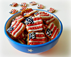 All these contain are waffle pretzels, red, white, and blue icing, and sprinkles. Of course, it would take a long time to decorate a whole bowl of them and then some from what I see here.