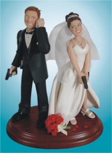 That groom better get off his cell phone now since I don't like the look on the bride's face. Seriously, all guns do is make these blushing newlyweds look like homicidal maniacs. Just saying.