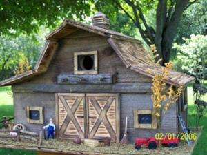 Now this one has a little farmer and tractor. But I have to love the rustic woodwork in this as well as the fine craftsmanship. But I'm sure this is way too small for any actual farm animals.