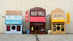 Now there are a bunch of birdhouses like these. These 3 shown are Jail Birds Bail Bonds, Night Owls  Bar, and Seedy's Liquors. Seems kind of like a seedy place to me. But I'm sure some birds must enjoy the place.