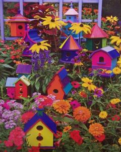 Now these birdhouses seem to almost blend in with the flowers. But funky colors will certainly draw a bird's attention, if anything. But I do think they're all lovely in their own way.