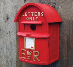 Now this is a birdhouse from Britain as you can see by how it's painted red and has the initials ER on it. Still, seems like Britain seems to have a problem with birds living in their mailboxes as it looks like.