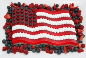 Now this has a red jello decorated with whipped cream and blueberries. It's also surrounded by fruit, too.