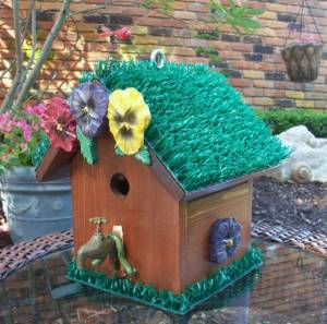 I know this is supposed to be a garden birdhouse. But I'm not sure what any bird would want to do with fake pansies and artificial turf.  Also, I'm sure the faucet is for decoration.