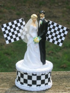Of course, this would've been a perfectly nice wedding cake topper if it didn't have the checkered flags on it. Yeah, that just looks tacky to say the least. Perhaps they should cover the bride and groom with corporate sponsor logos, too.