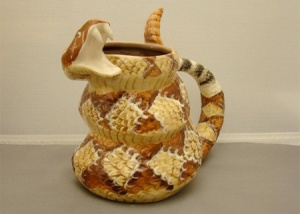 Now this is perhaps one of the most intimidating mugs I've ever seen. Seems like this rattlesnake really isn't too happy and guards his morning joe with a vigilance.