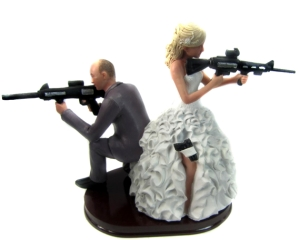 Just when you think you've seen enough wedding cake toppers with guns on them, they come out with another one. Now I get that a lot of people like guns but still hate to put my politics in this, but guns kill people. It's their purpose. And you wonder why we can't get gun control.