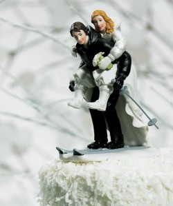 I'm not sure skiing down from a multi-tiered wedding cake is going to be good for these figurines. Perhaps this couple is going on a ski resort for their honeymoon.