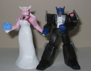 Hmmm....didn't know they had a pink Transformer. Then again, robots don't have gender anyway. Still, a few explosions and it would be like the live action Michael Bay series that keeps making money despite not having plot.