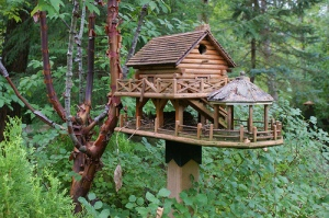 Now this cabin not only has a porch, it also has a gazebo along with it, too. Not to mention, one pair has already built a nest in it as well.