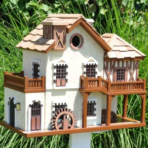 Now this is said to be a watermill cottage with a porch all around. I'm sure the waterwheel is fake in this. But at least this birdhouse doesn't include a birdbath.