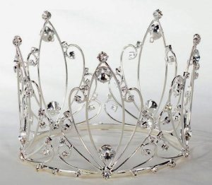 Seriously, a crown for a wedding cake? For God's sake shouldn't the bride be a princess for the day?  Also, why does this even exist?