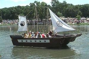 Seems like a boat like this can go with sails and rows. Wonder why they have rope ladders to the masts.