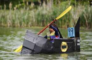 I'm sure the real Batcanoe would be far more impressive. But this kid looks quite cute rowing it.