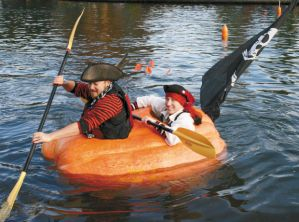 I think there's an actual regatta with pumpkin boats as far as I've seen on Google Images. Still, how they managed to find pumpkins this big to carve out, I'll never know.