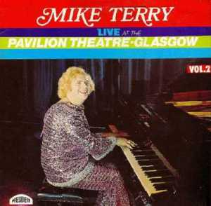 Seems like Liberace was such a success in the United States that the Brits wanted a flamboyantly gay concert pianist of their own. Seems like Mike Terry happened to be it in his sparkly attire.