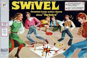 Like Groop Loop, Swivel also inspires some degree of family friendly bondage and randy horseplay. Yet, the difference with this one is that the players have to knock off opponents' cones and they tie ropes around their waists with pendulums in the middle.