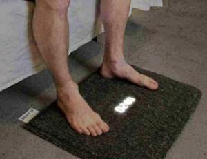 Actually this is an alarm clock rug. Still, I'm not sure if I'd want something that would have to make me step on the snooze button.