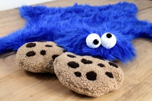 Yes, this is a Cookie Monster skin rug. And yes, it comes with cookies. Said to be marketed for families. But I guarantee this might traumatize some children.