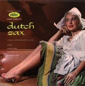 Hate to inflict some political correctness, but I think the outfit is a bit stereotypical. If not, then anachronistic or possibly more appropriate for a polka album. Still, at least she's in high heels and nylons. But for God's sake Dutch people don't dress like that. Never have.