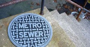 Of course, I'm sure you can wipe your feet on it. But you'd probably be disappointed that lifting it won't lead you to a sewer.