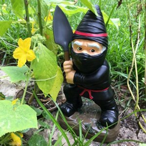 Actually most ninjas didn't wear black in real life since they functioned like covert agents and snipers. They usually dressed as peasants so the invisibility was psychological. However, this garden gnome ninja is just perfect.