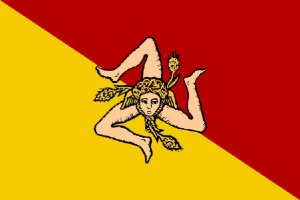 Now what's freakier than a flag with 3 disembodied legs? Well, a flag with 3 disembodied leg triskelion and a face on it. Add 3 stalks of wheat and a pair of wings coming out as well. Now that's what I called freaky. Yeah, wonder what the Sicily's flag designer was on when he came up with that idea.