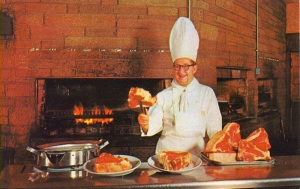 "From the card: ""A picturesque view of George Diamond preparing a steak before one of his open charcoal broilers. A full steak dinner starts at $1.95."" Picturesque, really? Still, $1.95 for a steak dinner like that ain't bad. But I think the chef seems to be enjoying himself a bit too much."