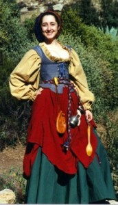 On her skirt, she has all the necessary things such as her money purse, her goblet, and her wooden spoon. I'm sure the goblet isn't made from fine metal. Else, someone might miss it.