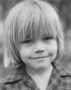 Yes, that's Leonardo DiCaprio. Well, he was a kid in the 1970s so his parents probably thought that hairstyle was cute. Of course, he'd end up becoming a star after Titanic. But he should've been nominated for Django Unchained.