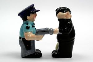 Well, at least the good thing about this cops and robbers salt and pepper shaker is that they're both of the same race. Let's just say if the robber had darker skin, you could have some unfortunate implications.