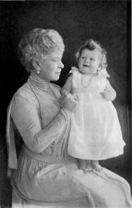 Here is the future queen on her grandmother Queen Mary's lap. Of course, she wasn't known to be a warm and fuzzy sort. More like a kleptomaniac and a jewel collector.