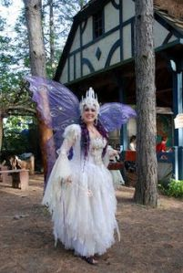 Yes, you see a lot of people dressed as fairies at the Renaissance Festival. Of course, I'm not sure if she's a fairy godmother but her dress is quite elaborate.