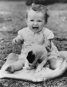 Seemed to be such a smiley baby and loved puppies. Of course, she might've been quite the diva as well. Still, she'll grow up to be one of Hollywood's most illustrious actresses of all time.