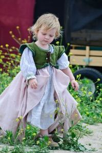 Sure she looks so adorable in that little dress of hers. However, I'm sure a boy would've worn that outfit just as easily during the 16th century.