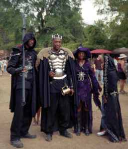 Now just a family at the Renaissance Festival in their costumes. But, yes, you'd expect movie fantasy villains to wear such badass outfits, especially in the 1980s. Kind of funny if you think about it.
