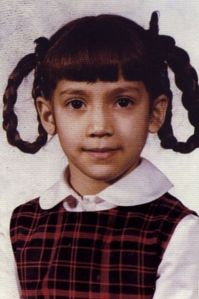Normally, when I hear about J. Lo, an image of a little girl in a dress and braid loops doesn't really come to mind. I'm not sure why. Still, this is an adorable picture.