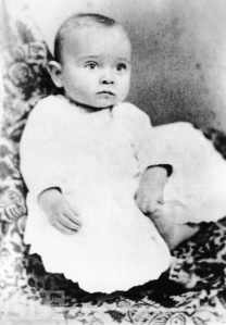 Yes, this is baby Harry Truman who'd later grow up to become one of the most wise ass presidents of the United States. Of course, at this moment he's basically dropping atomic bombs in his diapers (metaphorically speaking, of course).