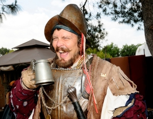 Actually, that's just a guy at the Renaissance Festival enjoying a drink who happens to be dressed as one. Then again, this wasn't an unusual military style during the 16th century. Or the early 17th, Let's hope he doesn't spread smallpox or kill any Indians.