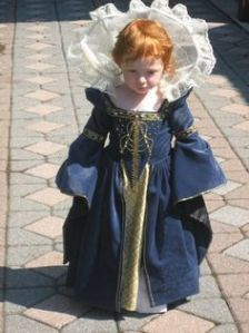 Yes, she's cute in her little dress. I'm sure Queen Elizabeth I wore the same thing when she was her age (sarcasm).