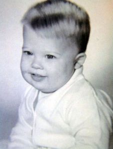 Such a little guy and he's already sporting one of his iconic hairstyles. Still, he's just so adorable in this picture.