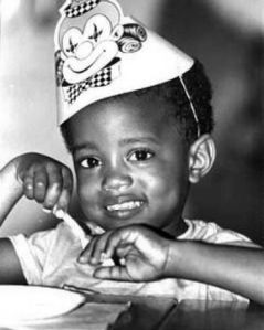 Of course, this little boy will soon become an obnoxious rapper who will interrupt Taylor Swift's awards speech at the VMAs. He'd also marry Kim Kardashian and name his daughter North. But isn't he so adorable in that clown hat?