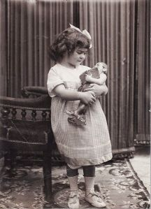 Here's the future painter holding a doll with a book in its hand. Of course, because of health problems and an accident in her teenage years, Frida will be unable to have children. So she kept a bunch of monkeys instead. Not to mention, she was married to Diego Rivera.