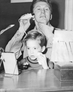 Seems like someone wants to shave like his daddy, Kirk Douglas (who'd later play Spartacus). Still, I'm sure little Michael is bound up to grow up looking just like him (sans the distinctive voice and dimple chin).