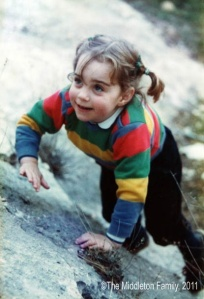 Here we see the future princess climbing a rock in her pigtails. Of course, when her prince comes, little would she know that he'd be an actual prince. Prince William, anyway.
