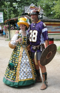 He likes the Minnesota Vikings and she likes the Greenbay Packers. But at least they seem to have an activity that they can enjoy together. Love her cheese hat by the way.