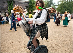 Now I understand why he's not riding a horse. But I'm not sure a Segway makes an appropriate substitute. He's better off getting a friend follow him banging coconut shells.