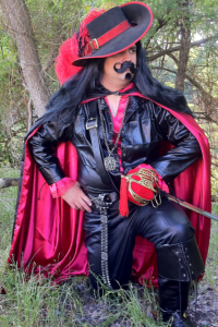 He's supposed to be a dark musketeer. But I wouldn't be surprised if he had a sex dungeon in his basement. Not that there's anything wrong with that. Well, unless he doesn't keep it safe, sane, and consensual.